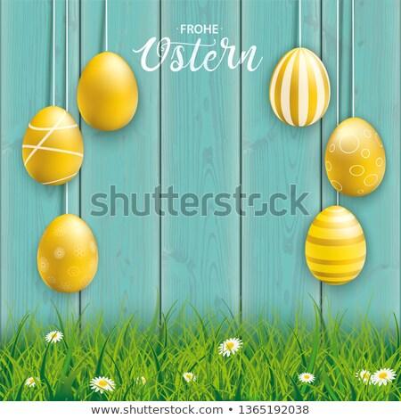 Akasztás arany kellemes húsvétot tojások ciánkék fa Stock fotó © limbi007