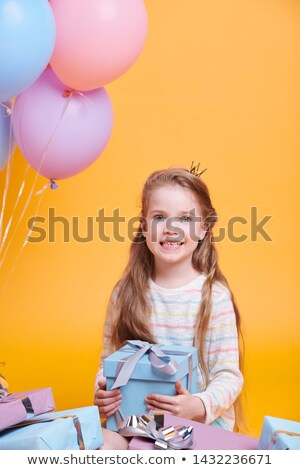 Pretty little princess with long hair holding giftbox Stock photo © pressmaster