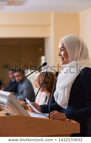 Bastante jóvenes sonriendo musulmanes femenino orador Foto stock © pressmaster