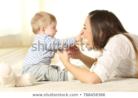 Mother and baby playing and smiling, happy family indoors  Stock photo © dashapetrenko