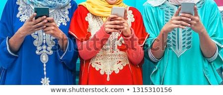 Teenagers using mobile to chatting. Stock photo © ijeab