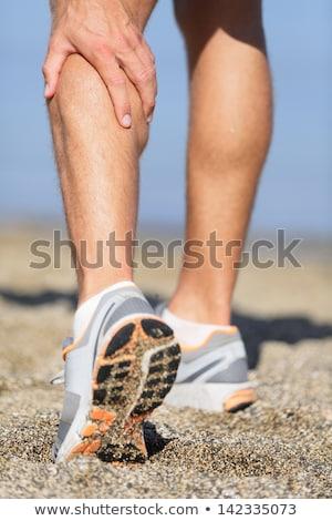 futó · tart · sebesült · láb · közelkép · női - stock fotó © AndreyPopov