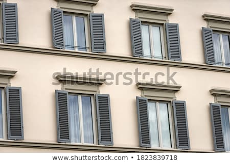 Street with old traditional Italian houses with wooden windows in Florence, Italy Stock photo © Zhukow
