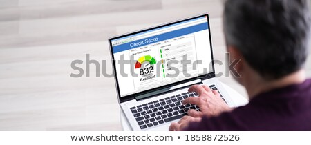 Man Checking Credit Score On Laptop At Home Stock photo © AndreyPopov