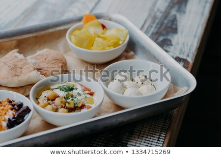 Tasty traditional dish concept. Cropped shot of tray with goat cheese, pita bread, grilled beetroot  Stock photo © vkstudio