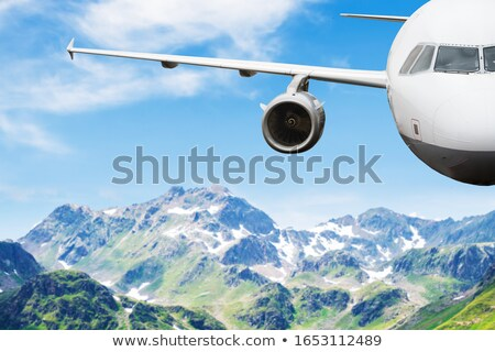 Airplane Flying In Clear Sky Against Mountains In Austria Stock photo © AndreyPopov