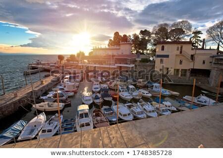 Város vízpart kikötő naplemente kilátás tengerpart Stock fotó © xbrchx