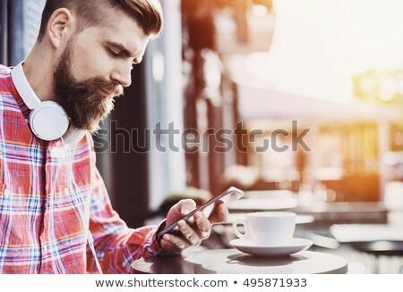 男 スマートフォン 近い 顔 あごひげを生やした ストックフォト © Giulio_Fornasar