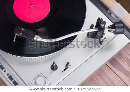 Vintage record player with vinil disc on a wooden table. Stock photo © artjazz