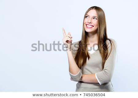 sonriendo · empresarial · mujer · senalando · negocios · mujeres - foto stock © williv