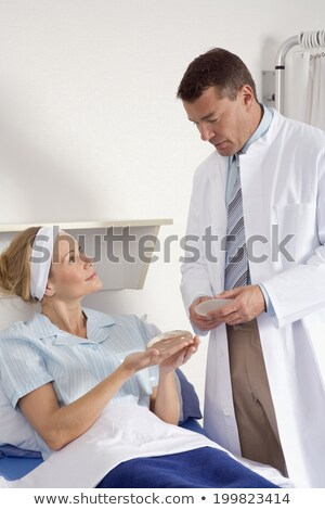 Plastic surgery female doctor point patient breast stock photo © CandyboxPhoto