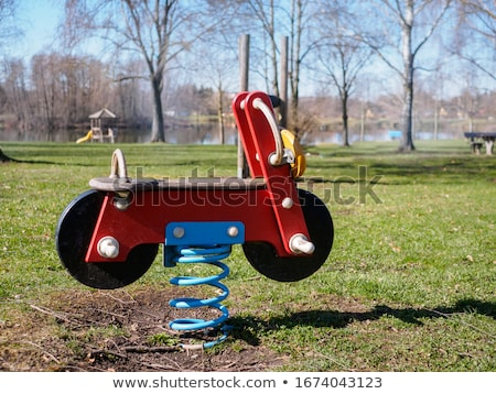 dziecko · huśtawka · młodych · gry · dzieci · pomarańczowy - zdjęcia stock © ivonnewierink