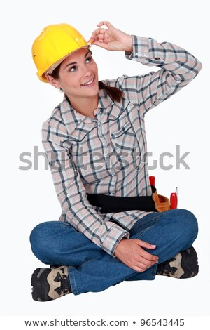 Tradeswoman touching the brim of her hat Stock photo © photography33