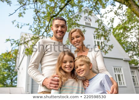 Mother and daughter in the front yard Stock photo © photography33