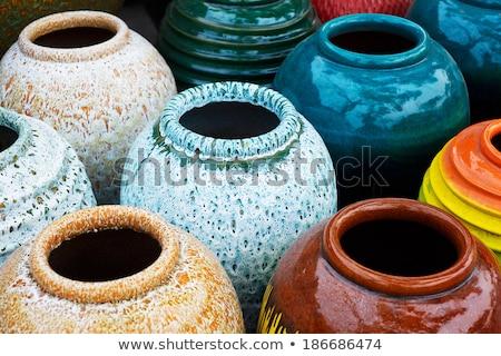 Jar aardewerk geïsoleerd witte oranje drinken Stockfoto © Witthaya
