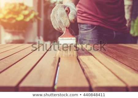 Man painting wooden plank stock photo © photography33