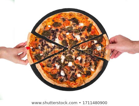 Tasty pizza and hand on black background stock photo © ozaiachin