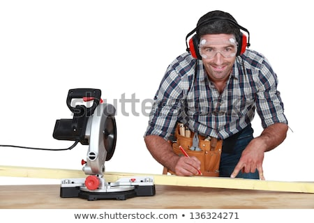 Man with band saw marking wood Stock photo © photography33