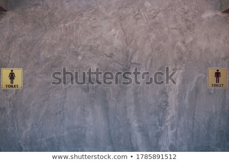 ancient toilet sign on cement wall stock photo © inxti