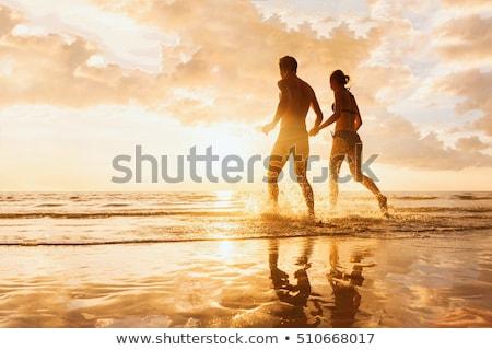 пару · пляж · играет · женщину · лет · улыбаясь - Сток-фото © photography33