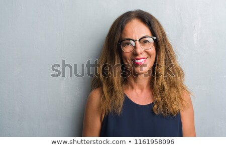 middle aged smiling woman in casual wear stock photo © stockyimages
