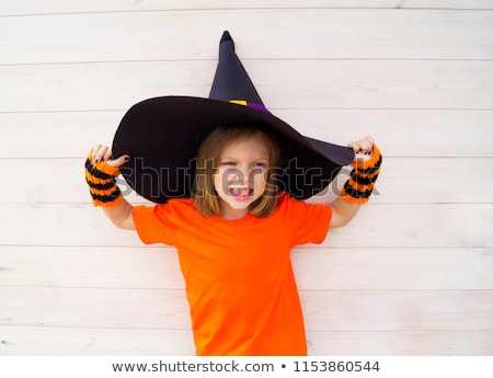 Cheerful girl in gloves with claws. Isolated Stock photo © acidgrey