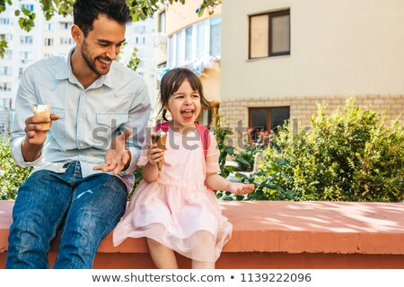 Father and daughter eating sweets stock photo © photography33
