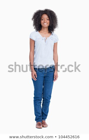 Young woman standing upright while beaming against a white background Stock photo © wavebreak_media
