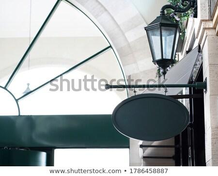 background from elliptic empty frame on iron black plate Stock photo © MiroNovak