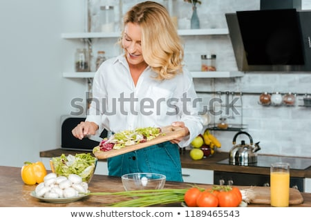 Mature Adult Woman Cooking Stock photo © luminastock