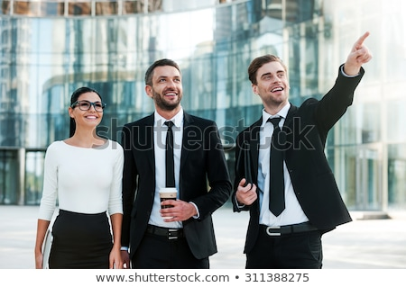 üzletasszony · mutat · másfelé · néz · boldog · fiatal · izolált - stock fotó © Maridav