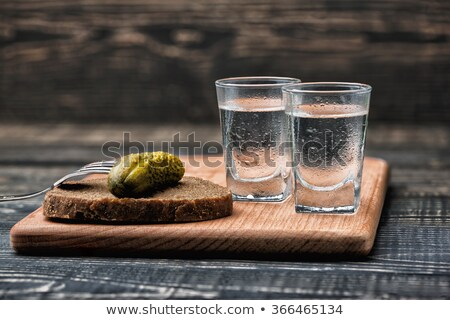 shot glasses of cold vodka stock photo © tarczas