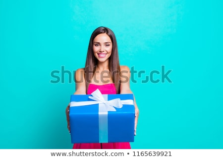 Woman holding a big wrapped package. Stock photo © photography33