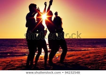 casal · praia · festa · potável · pôr · do · sol - foto stock © kzenon