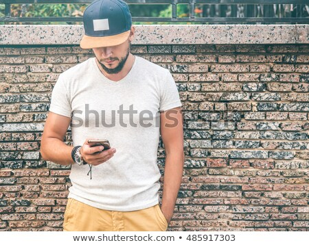 Businessman wearing a baseball cap Stock photo © stryjek