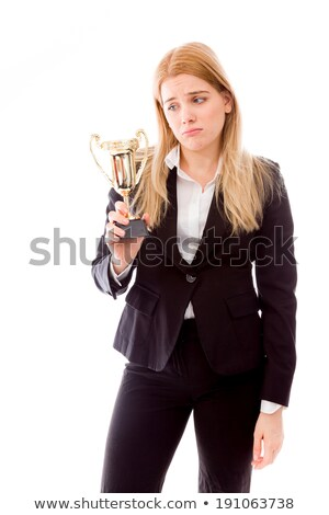 Disappointed businesswoman holding a golden trophy Stock photo © bmonteny