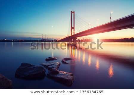 Backlit bridge at night and reflected in the water Stock photo © filipw