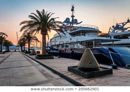 Barcos marina nascer do sol boné esportes barco Foto stock © alex_grichenko