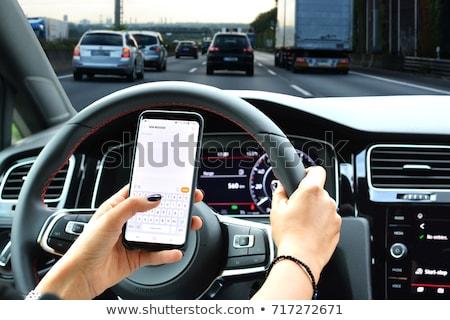 Nő küldés üzenetek autó fiatal nő lány Stock fotó © HASLOO