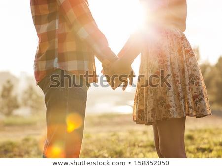 Silhouettes of young love couple Stock photo © stevanovicigor