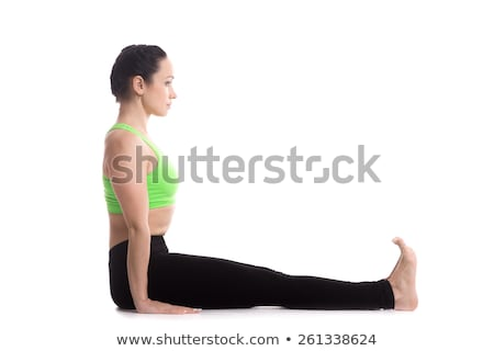girl sitting in yoga pose staff stock photo © orensila