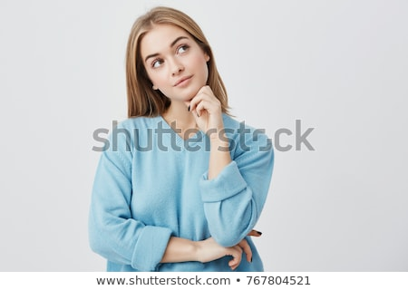 pretty young woman holding her long blond hair stock photo © dash