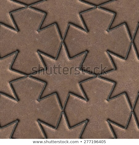 Stock photo: Brown Paving Slabs Laid in the Form of Stars and Crosses.