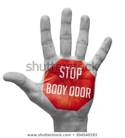 stop body odor concept on open hand stock photo © tashatuvango