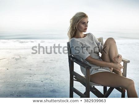 Belo sedutor loiro mulher vestido preto Foto stock © majdansky