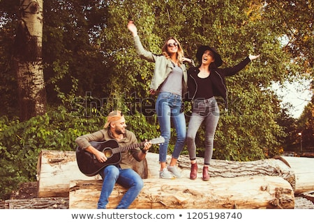 teenagers friends playing the guitar at autumn park stock photo © zurijeta