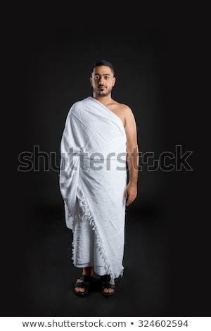 Fiatalember muszlim zarándok fehér hagyományos ruházat Stock fotó © zurijeta