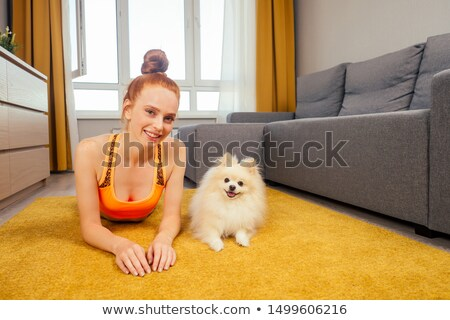 redheaded beautiful slim girl lying on a sofa Stock photo © Giulio_Fornasar