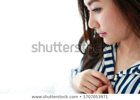 Beautiful undressed woman relaxes on bed Stock photo © Aikon