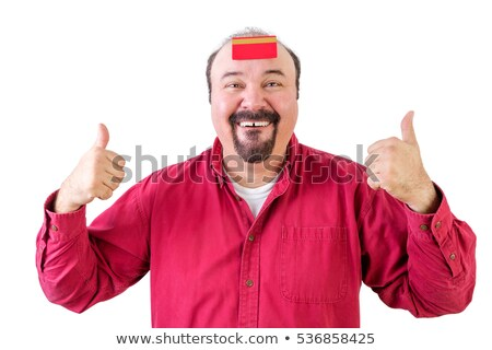 Man with thumbs up and credit card on forehead Stock photo © ozgur